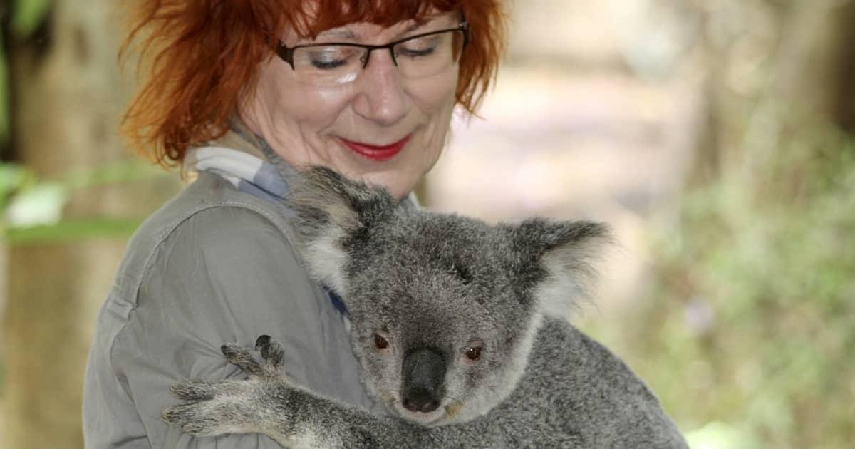 woman holding koala